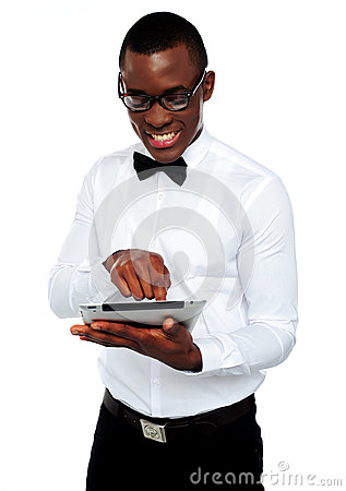 Smiling african boy using tablet-pc