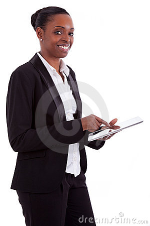 Smiling african businesswoman using a tablet