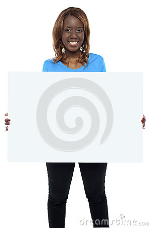 Smiling african female model holding billboard