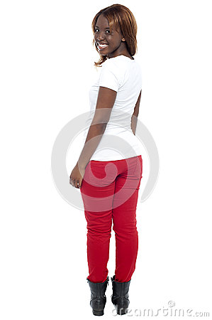 Smiling african lady in boots turning back