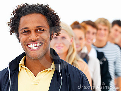Smiling African man with friends in the background