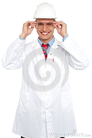 Smiling architect holding eyeglasses