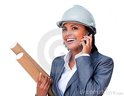 Smiling architect on phone wearing a hardhat