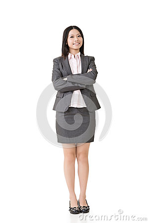 Smiling asian business woman with crossed arms