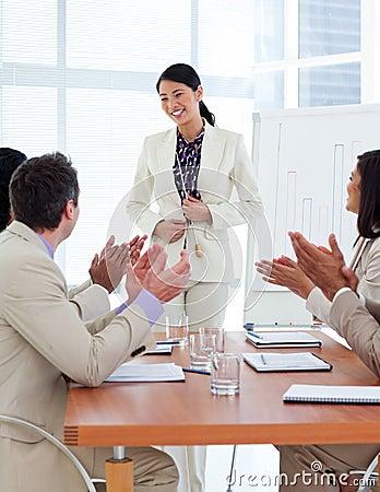 Free Smiling Asian Businesswoman Doing A Presentation Stock Photo - 12975590