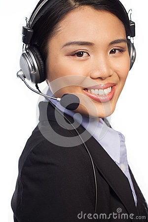 Smiling Asian call centre telephonist