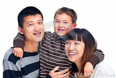 Smiling Asian family cut out on white