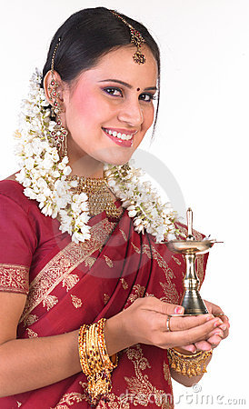 Smiling asian girl with the lamp