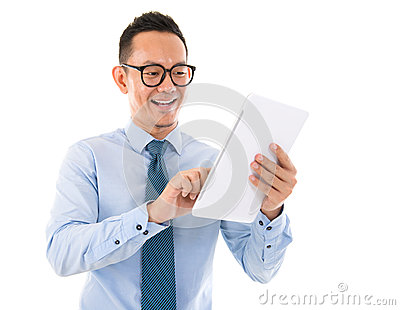 Smiling Asian man with tablet computer