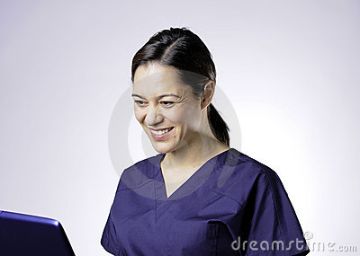Smiling asian medical assistant.
