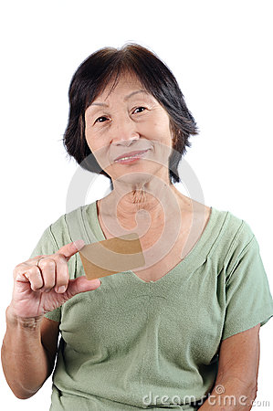 Smiling asian seniorwoman holding blank empty business card isol
