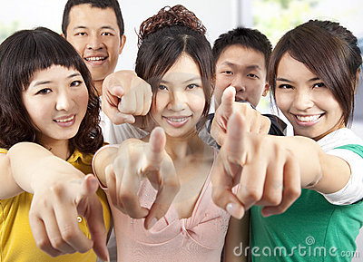 Smiling asian students pointing