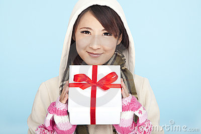 Smiling asian woman with a gift