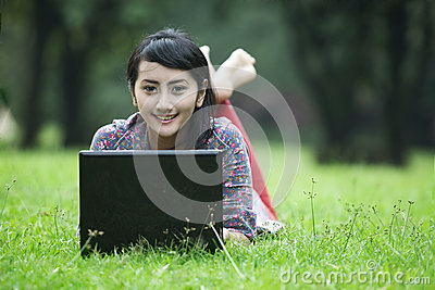 Smiling asian woman with laptop