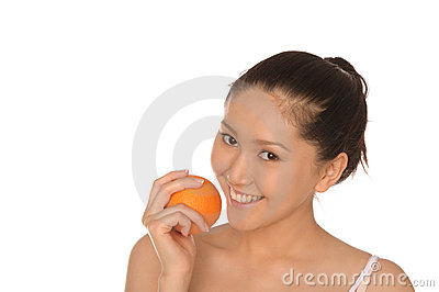 Smiling asian woman with orange