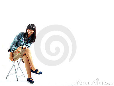 Smiling asian woman sitting on chair
