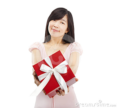 Smiling asian young woman holding gift