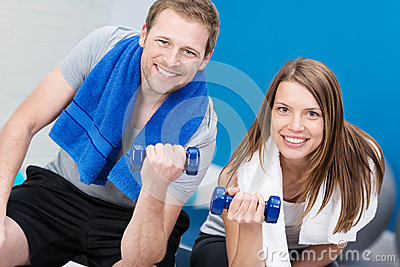 Smiling athletic couple working out together