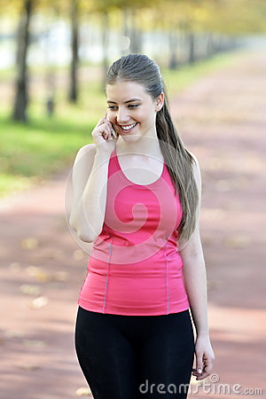 Smiling athletic woman take a rest after training