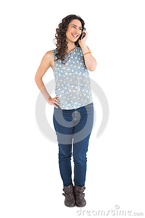 Smiling attractive brunette having phone call