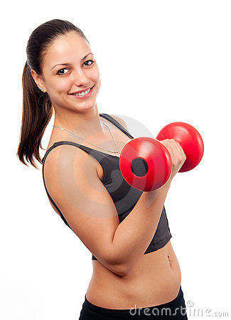 Smiling attractive woman exercising with dumbbell