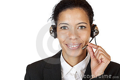 Smiling attractive woman makes with headset a call