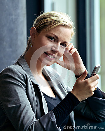 Smiling attractive woman texting