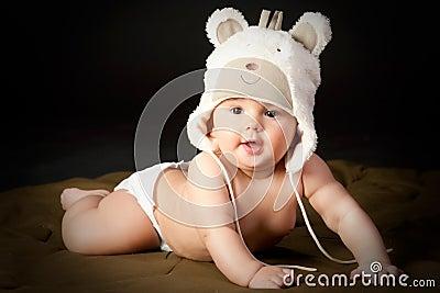 Smiling baby in bear cap