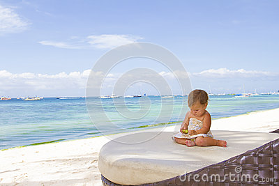 Smiling baby child on tropical sand beach