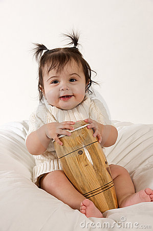 Smiling baby with drum