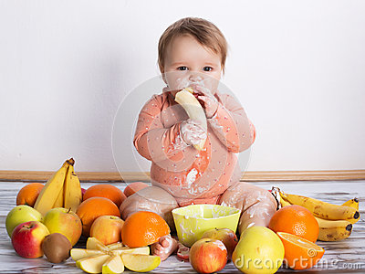 Smiling baby and fruits