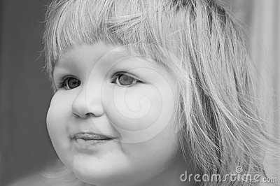 Smiling baby girl s portrait.