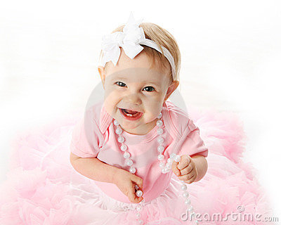 Smiling baby girl wearing pettiskirt tutu