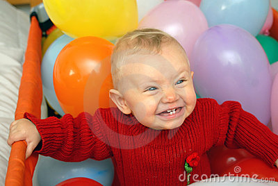 Smiling baby with globes