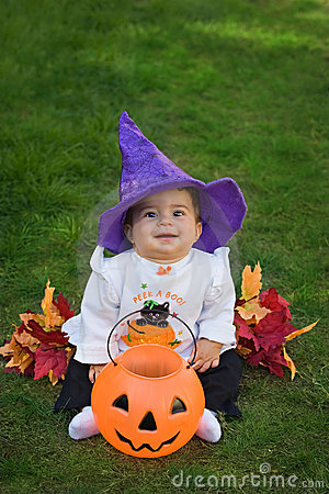 Smiling baby halloween witch