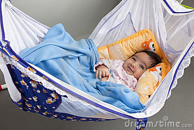 Smiling Baby in a Hammock-Style Cradle