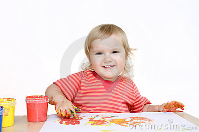 Smiling baby painting with finger