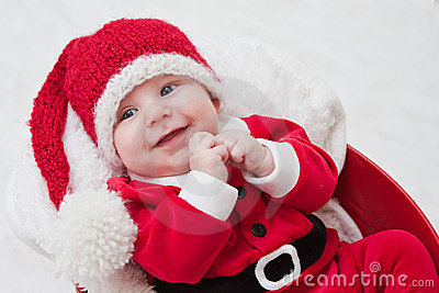 Smiling baby in Santa cap and outfit
