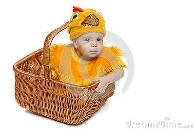 Smiling baby sitting in Easter basket in chicken costume