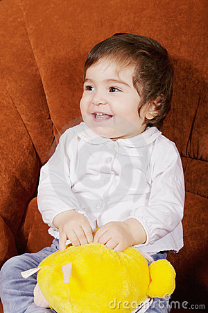 Smiling baby with soft toy
