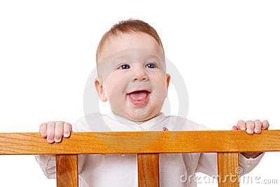 Smiling baby standing in bed