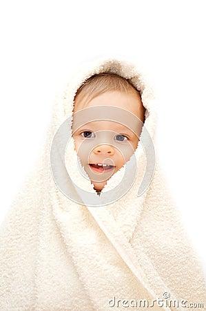 Smiling baby in towel