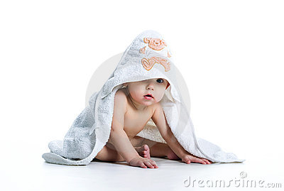 Smiling baby under the towel