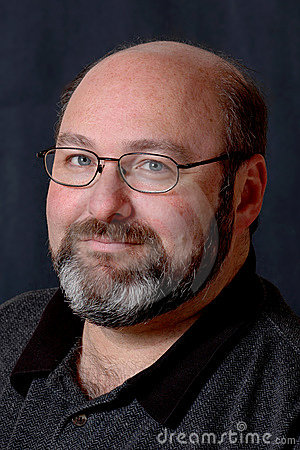 Smiling bald bearded man
