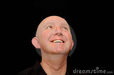 Smiling bald man looking up