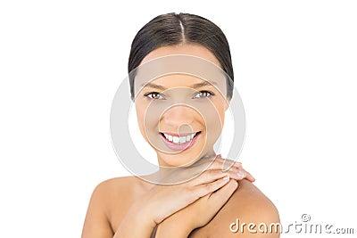 Smiling bare brunette posing