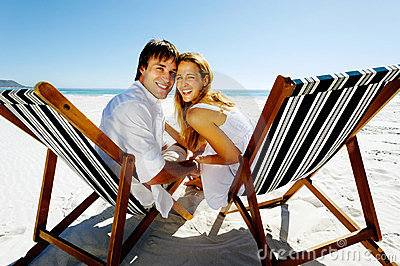 Smiling beach portrait couple
