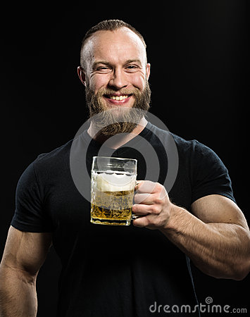 Free Smiling Bearded Man Drinking Beer From A Beer Mug Over Black Bac Stock Photo - 66852570