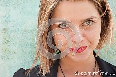 Smiling beautiful blonde woman staring