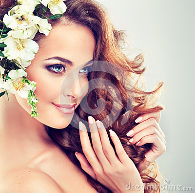Free Smiling Beautiful Girl.Delicate Pastel Flowers In Curly Hair Royalty Free Stock Image - 68967856